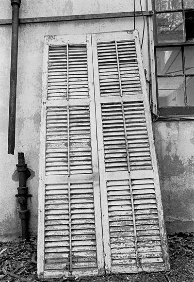 old shutter outside an abandoned house