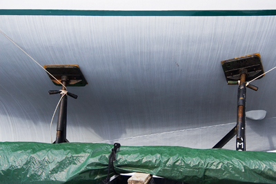 boat with green tarp