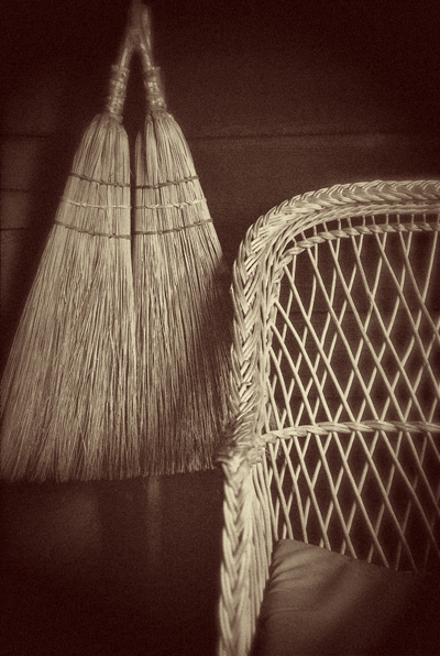 broom and wicker chair