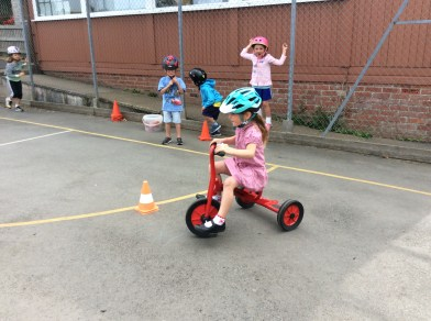 Slalom group back at base, using the school's trikes.