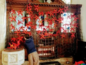 100 red poppies in the church, and another 11 purple ones representing the 11million animals that died.