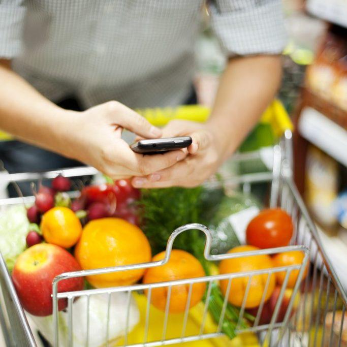 18120243 - man texting during shopping