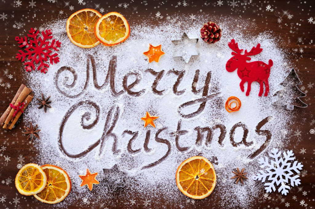 49526388 - merry christmas text made with flour with decorations on cutting board healthy christmas tips