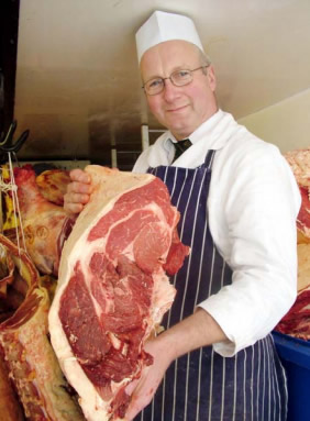 All meat – a real treat.' Butcher George Payne with the 100% beef that goes into his home-made burgers.