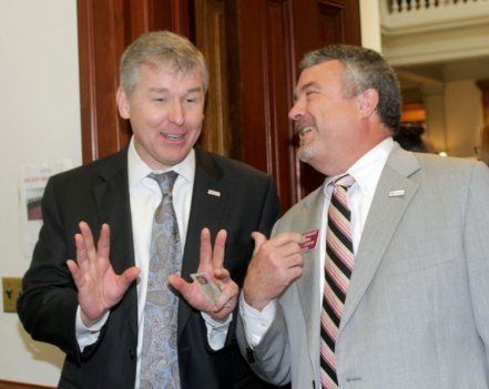Even notice how some people talk with their hands? 7th District Congressman Rob Woodall and State Rep. Earl Earhart of Powder Springs get into it while waiting to qualify.