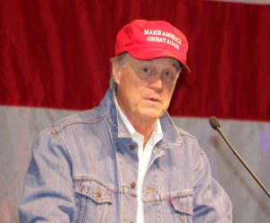 Sen. David Perdue dons  his jean jacket and a  Trump cap at the Georgia GOP convention.