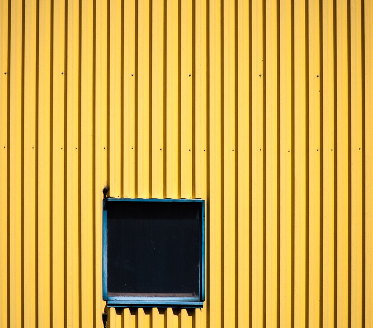 Window in Yellow Wall
