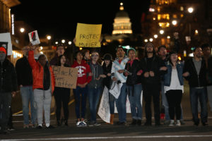 Several hundred protestors block the intersection of State street and 100 South as they take to the streets of Salt Lake City in support of Abdullahi Mohamed Monday, Feb. 29, 2016.