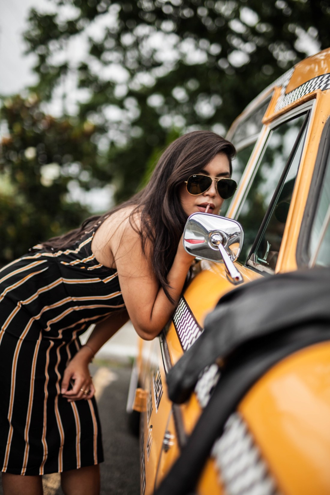 Editorial street style photoshoot with a vintage cab with a blogger