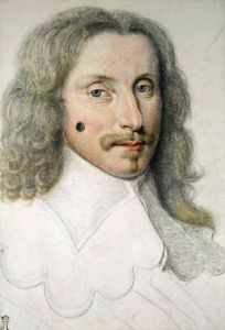 French mouche on a man's cheek