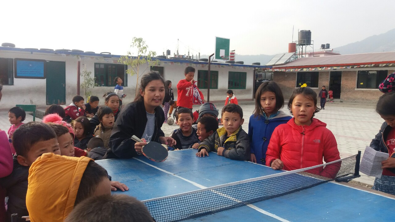 Lakpa plyaing with school kids