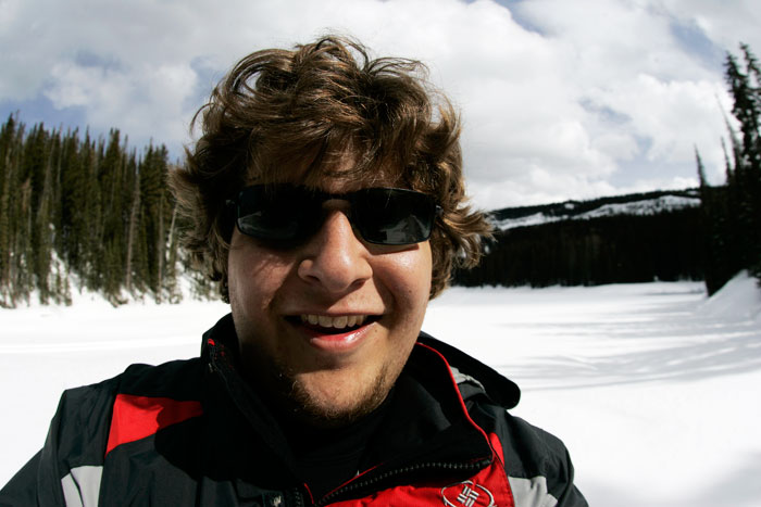 Canon EOS 1D MarkII — 15mm ISO 100 @ f/8 and 1/800 sec — I stopped for a self portrait in front of a snow covered lake while snowshoeing at Mesa Lakes.