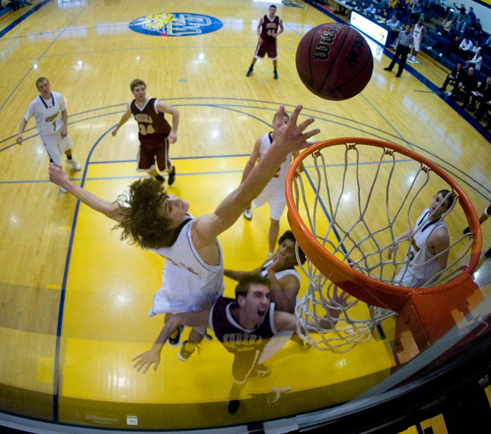 Honorable Mention Sports - Gorlok forward Steve Hrdlicka jumps to block a shot by the Eureka College Red Devils. Webster lead by 20 points at the half and closed out the game be increasing the lead to 30 points.
