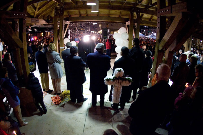 "1st Place News - A day after a Kirkwood resident gunned down fice city officials, more than 1,000 people gathered Feb. 8, 2008 for a candlelight vigil and prayer service. The hour-long service was held across the street from the Kirkwood City Hall, where Charles Lee ""Cookie"" Thornton shot and killed four City Council members before being gunned down."