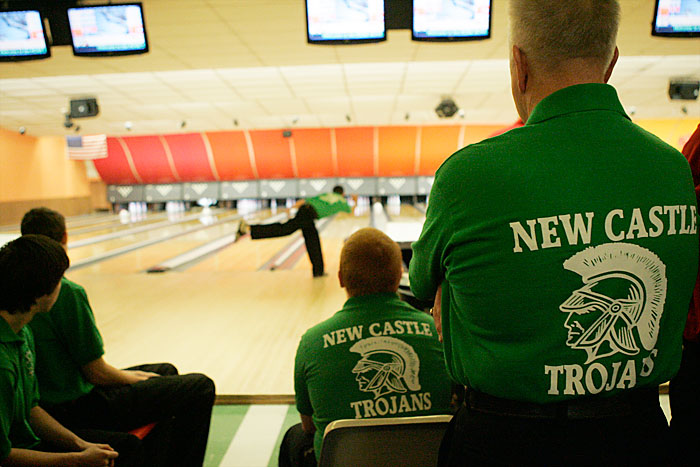 Trojans head coach Ronald Ragan (right) watches over his team during the first round of bowling Sunday morning at Rose Bowl for the Indiana High School Bowling Club Regional Tournament. The tournament was scheduled for Saturday but heavy snow in the area left many counties under a snow emergency. (C-T photo Max Gersh)