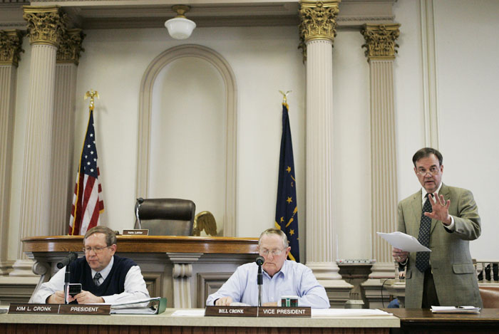 Scott Hayes, right, a New Castle-Henry County Economic Development Corp. board member, talks on Monday about problems the EDC has with a proposal for an economic development alliance while County Commissioners Kim Cronk and Bill Cronk listen. (C-T photo Max Gersh)