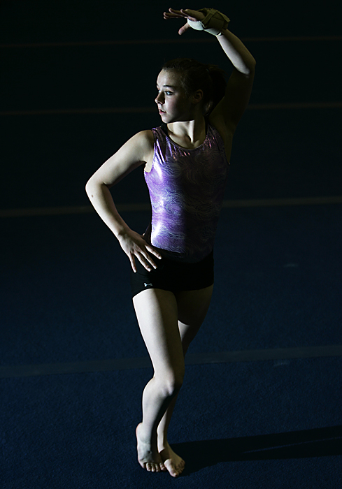 Ashlan Millikan poses parts of her floor routine in the path of my light. (C-T photo Max Gersh) ©2010