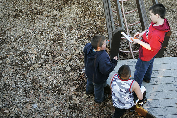 Kids load their airsoft guns on the playground in Baker Park. (C-T photo Max Gersh) ©2010