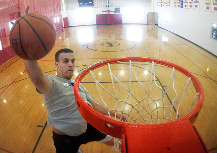 Michael Harsha is a trickster on the court. He practices his shots at the YMCA in New Castle. He played for the Trojans and graduated from New Castle Chrysler High School in 2009. (C-T photo Max Gersh) ©2010