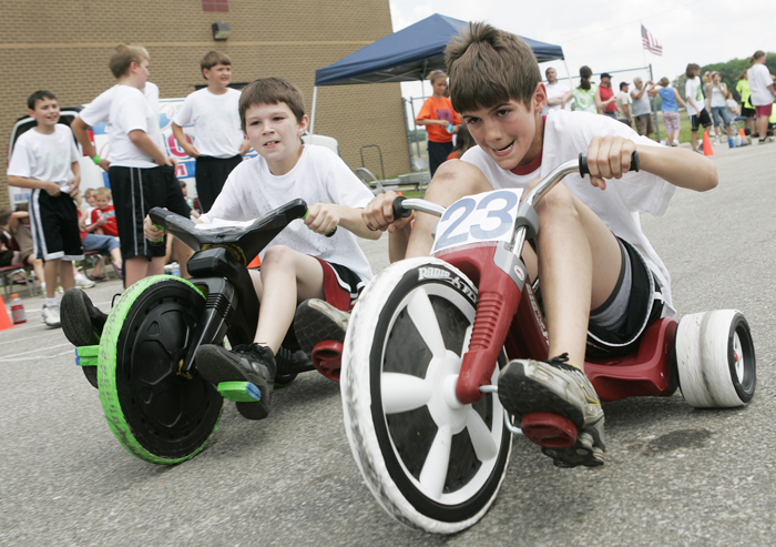 In this May 26, 2010 photo, Grant Jessup, number 23, pedals past his competition during the Titan 500, a 50 lap Big Wheel tricycle race at Tri Elementary School in Straughn, Ind. (AP Photo/The Courier-Times, Max Gersh) ©2010