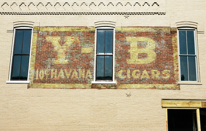 An old cigar ad remains on the side of what will be the Maxwell Commons in downtown New Castle after much of the building has received a coat of paint. (C-T photo Max Gersh) ©2010