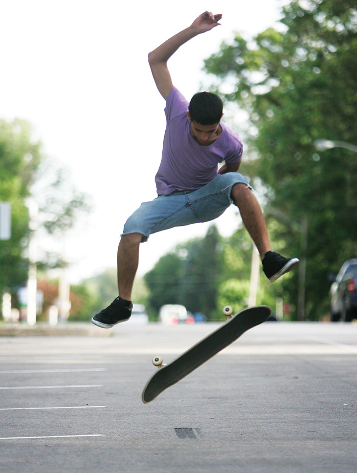 """Alex Chamberlin practices a 360 kickflip in a Baker Park parking lot Wednesday evening. """"This is the only place we really don't get in trouble for skating,"""" said Chamberlin. (C-T photo Max Gersh) ©2010"""