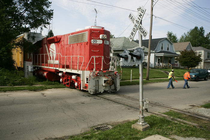 A train engine blocks part of A Avenue Friday morning as it connects with train cars that have been stored on New Castle tracks for over two years. (C-T photo Max Gersh) ©2010