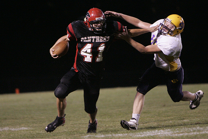 Knightstown's running back stiff-arms a Hagerstown defender. (C-T photo Max Gersh) ©2010