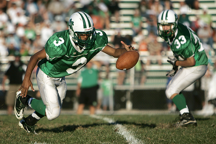 New Castle QB scrambling after missing a snap. (C-T photo Max Gersh) ©2010