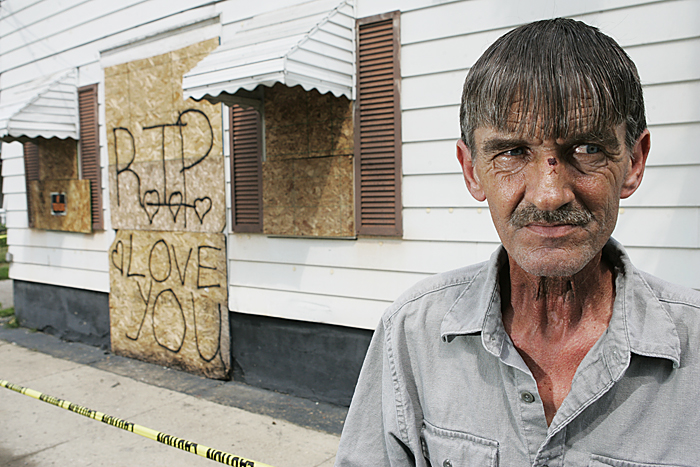 David Johnson stands in front of a home on 18th Street where an early morning fire on July 16 left one woman dead. Johnson lives in a neighboring building and tried to rescue as many people as possible when he saw the fire. (C-T photo Max Gersh) ©2010