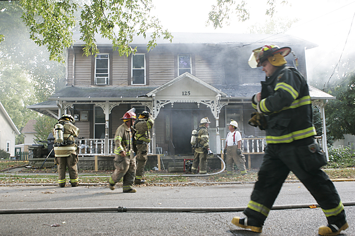 Firefighters finish extinguishing a house fire Thursday afternoon in Spiceland. The homeowners were downstairs when a neighbor alerted them of the fire which was visible in the upstairs windows. (C-T photo Max Gersh) ©2010