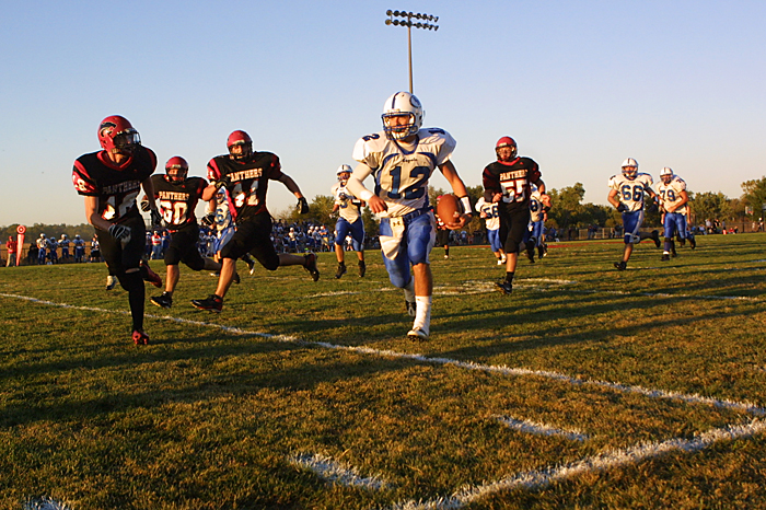 Knightstown defenders chase after Eastern Hancock quarterback Steven Stunda as he scrambles with the ball. Knightstown won the game 41-6. (C-T photo Max Gersh ©2010
