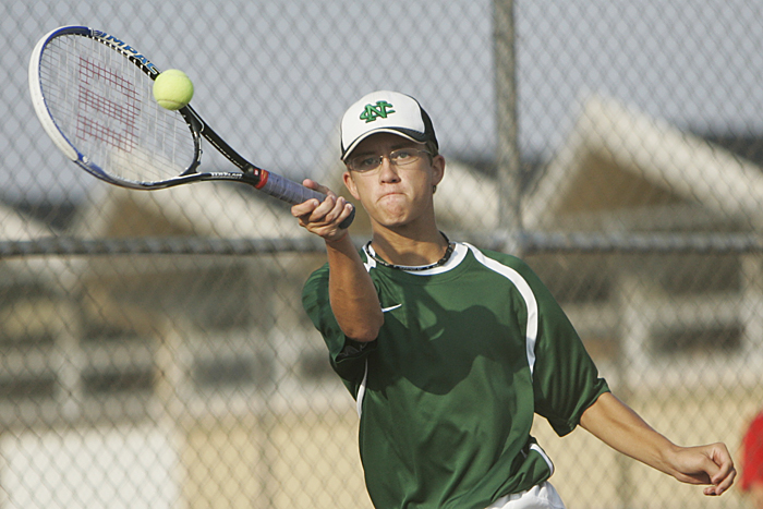New Castle's A.J. York volleys against an Anderson player Thursday afternoon during the No. 3 singles match. York lost in two sets, 6-3, 6-4. (C-T photo Max Gersh) ©2010