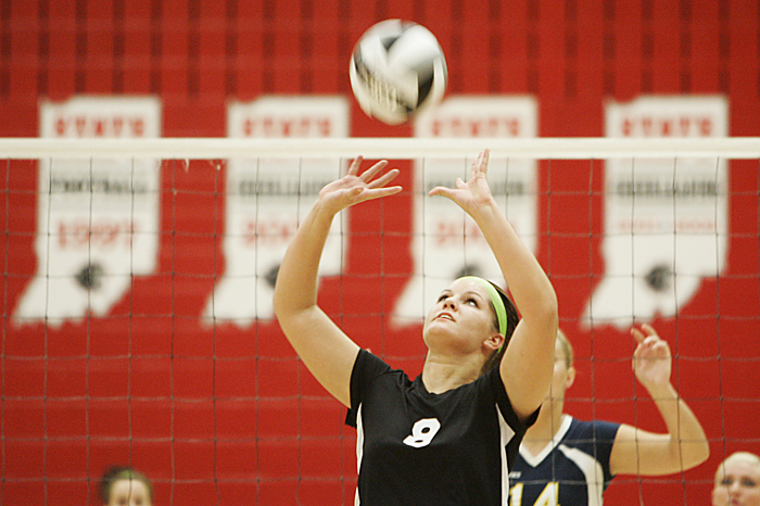 Knightstown's Hannah Jackson sets the ball Thursday in a home meet against Shenandoah. (C-T photo Max Gersh) ©2010