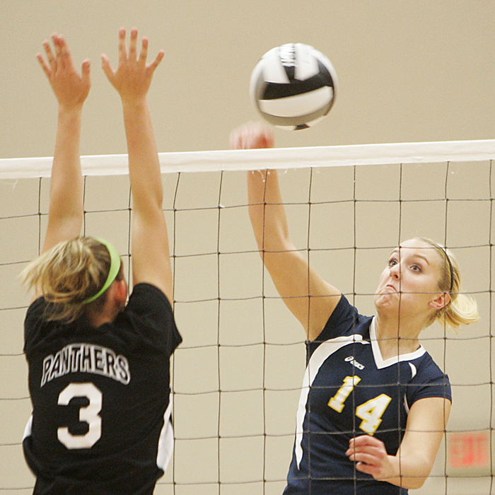 Shenandoah's Yardley Collett slams the ball past the block of Knightstown's Hannah Smith. (C-T photo Max Gersh) ©2010