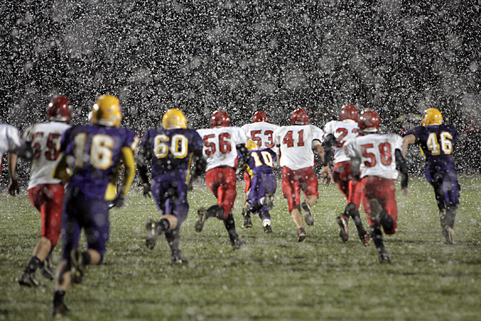 Knightstown (white) and Hagerstown players run downfield during the first half of play Friday night. (C-T photo Max Gersh) ©2010