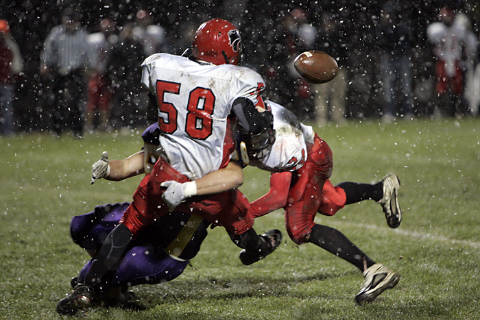 A Hagerstown defender pops the ball out of the arms of Knightstown's #58 Friday night. (C-T photo Max Gersh) ©2010