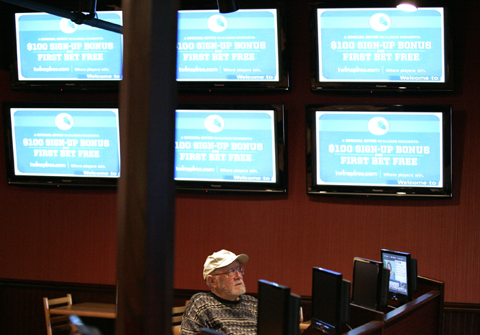 MAX GERSH | ROCKFORD REGISTER STAR ©2011 Clarence Holmes watches horse races Monday, Jan. 10, 2011, at the off track betting facility at Don Carter Lanes in Rockford.