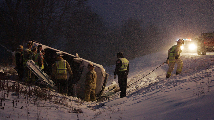 MAX GERSH | ROCKFORD REGISTER STAR ©2010 Blackhawk firefighters work to free a man trapped in a gray Chevrolet Malibu Monday night on US Bypass 20 at near Simpson Road. Fire Chief Harry Tallacksen said the driver's injuries weren't critical.