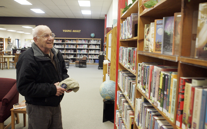 MAX GERSH   ROCKFORD REGISTER STAR Richard Lindquist looks for a book Tuesday, March 1, 2011, at the Pecatonica Library. ©2011