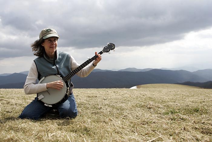 Gavin's aunt smoking the strings on my banjo at Max Patch in North Carolina. ©2011 Max Gersh
