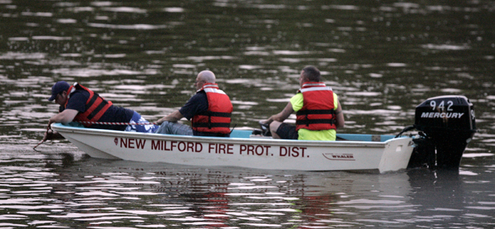 MAX GERSH | ROCKFORD REGISTER STAR Emergency responders from the New Milford Fire Protection District search the Rock River Saturday, June 4, 2011, after a call came in for a river rescue near Silver Creek Road in southern Winnebago County. ©2011