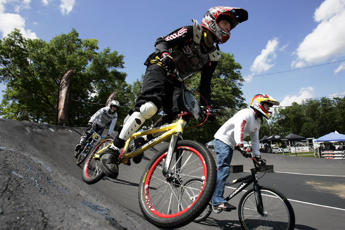 MAX GERSH | ROCKFORD REGISTER STAR Brandon Ceslok (center), 15, of Janesville, Wis., takes the outside edge on a turn Thursday, June 16, 2011, during practice runs for the ABA BMX Midwest Nationals at Searls Park in Rockford. ©2011