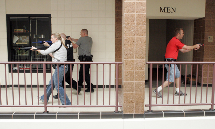 MAX GERSH | ROCKFORD REGISTER STAR Officers cover a hallway Wednesday, Aug. 10, 2011, during rapid deployment to an active shooter training at Harlem High School in Machesney Park. ©2011