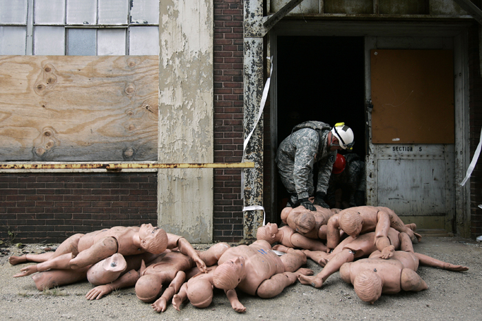MAX GERSH | ROCKFORD REGISTER STAR National Guardsmen pile dummies outside of a door Wednesday, Nov. 2, 2011, at the Barber Colman complex in Rockford. The National Guard and Rockford Fire Department were training in the building to simulate a rescue scenario in a tornado damaged structure.