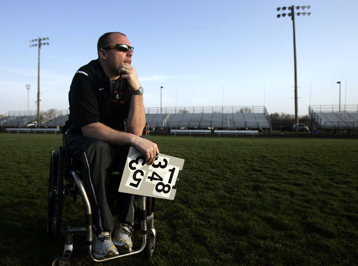 MAX GERSH | ROCKFORD REGISTER STAR Harlem High School Assistant Track Coach Kelsey Lueshen watches a race Wednesday, April 13, 2011, from the infield at Hononegah High School in Rockton. ©2011