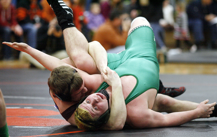 Dakota's Drew Zellmer (left) works to pin Rock Falls' Shawn Skinner in the 195-pound bout Tuesday, Feb. 19, 2013, during the wrestling sectional at Byron High School. MAX GERSH/ROCKFORD REGISTER STAR ©2013