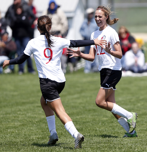 Stillman Valley's Tatum Glendenning (9) goes to hug teammate Abigail Timm (22) after Timm scored the team's second goal against Byron Saturday, May 11, 2013, during a game at Stillman Valley High School. MAX GERSH/ROCKFORD REGISTER STAR ©2013