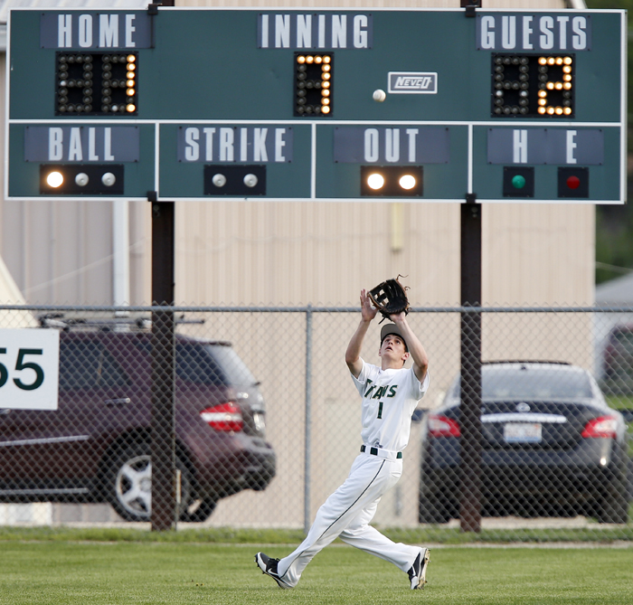 Outfielder catch by scoreboard