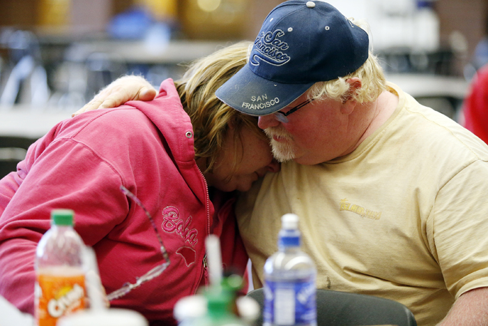 Marilyn Turner cries on her husband, Al's, shoulder after being evacuated to Pecatonica High School Sunday, June 2, 2013, in Pecatonica. The Turner's home sits in front of the Nova-Kem chemical plant. A firefighter told Marilyn that her 24 chickens had survived the the explosion and fire at the nearby plant. MAX GERSH/ROCKFORD REGISTER STAR ©2013